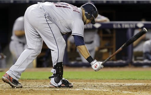 Cleveland Indians catcher Carlos Santana (41) slams his bat on the ground after striking out with a runner on second in the top of the sixth inning during the Indians' 6-4 loss to the New York Yankees in their baseball game at Yankee Stadium in New York, Tuesday, June 26, 2012. (AP Photo/Kathy Willens)