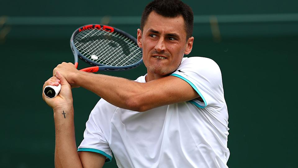 Bernard Tomic, pictured here in action at Wimbledon in 2019.