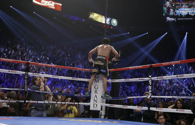 Juan Manuel Marquez, from Mexico celebrates his win over Manny Pacquiao in their WBO world welterweight fight Saturday, Dec. 8, 2012, in Las Vegas. (AP Photo/Julie Jacobson)