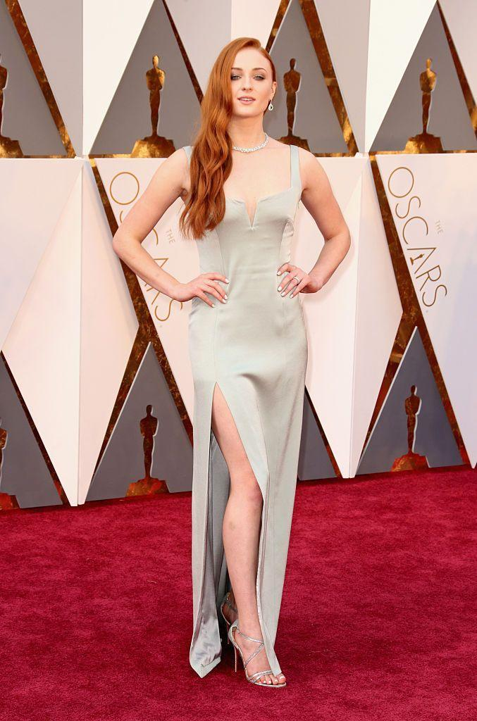 <p>To suit her Sansa Stark flame-red hair, Turner wore a sage Galvan dress with Louboutin heels to the 2016 Oscars.</p>