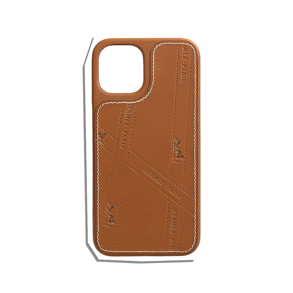 """Made of the softest leather to develop a natural patina over time, dad deserves this super luxe phone case that looks great but offers robust protection for what's probably one of his prized possessions. $570, Apple. <a href=""""https://www.apple.com/shop/product/HPLR2ZM/A/herm%C3%A8s-bolduc-leather-case-with-magsafe-for-iphone-12-12-pro?"""" rel=""""nofollow noopener"""" target=""""_blank"""" data-ylk=""""slk:Get it now!"""" class=""""link rapid-noclick-resp"""">Get it now!</a>"""