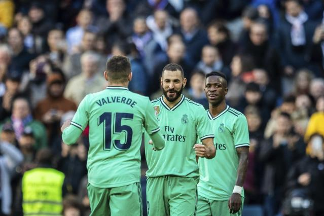 Real Madrid's Karim Benzema, center, celebrates after scoring during a Spanish La Liga soccer match between Real Madrid and RCD Espanyol at the Santiago Bernabeu stadium in Madrid, Saturday Dec. 7, 2019. (AP Photo/Bernat Armangue)