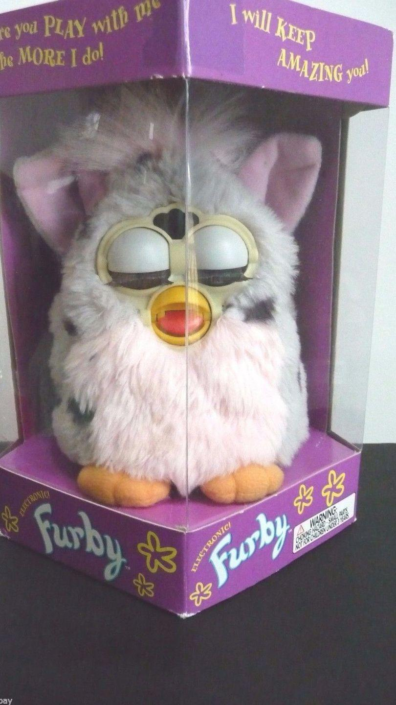 """<p>These furry, interactive toys came on the scene in 1998. If you're holding on to <a href=""""https://www.ebay.com/sch/i.html?_from=R40&_nkw=original%20furby&_sacat=0&rt=nc&_udlo=800&_udhi=1000"""" rel=""""nofollow noopener"""" target=""""_blank"""" data-ylk=""""slk:an early version in an unopened box"""" class=""""link rapid-noclick-resp"""">an early version in an unopened box</a>, you could expect it to fetch about $900. </p>"""
