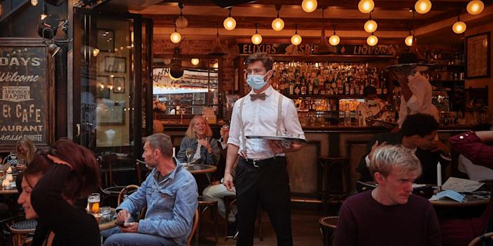 """A waiter looks out on the terrace of a Paris bar during the coronavirus pandemic on September 24, 2020. <p class=""""copyright"""">Kiran Ridley/Getty Images</p>"""