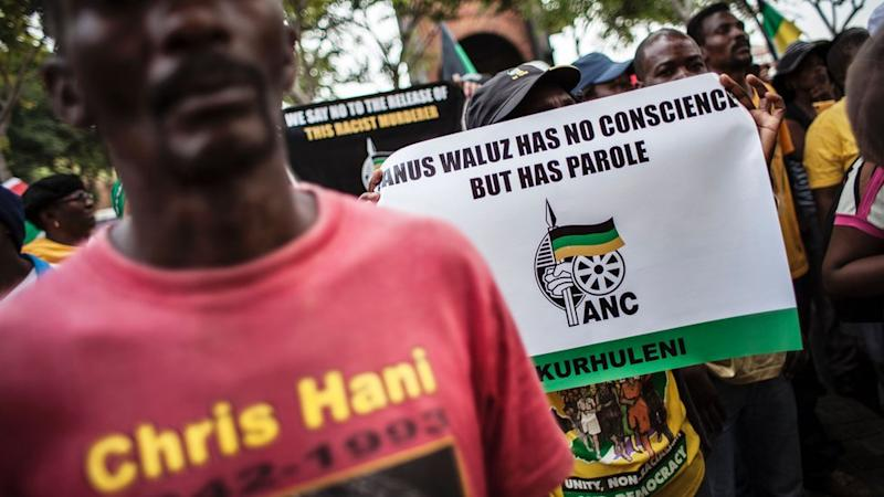 Members of the African National Congress (ANC) demonstrate outside the Constitutional Court in protest over the parole granted to Janusz Walus, the killer of the anti-apartheid hero Chris Hani