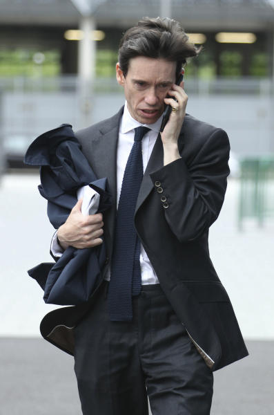 Conservative party leadership contender Rory Stewart arrives at the television studios ahead of a scheduled live television debate for the Conservative Party leadership candidates, in London, Sunday June 16, 2019.  Five out of the six candidates will appear in the first TV debate, with Boris Johnson declining to take part, although other candidates accuse him of trying to avoid scrutiny. (Yui Mok/PA via AP)