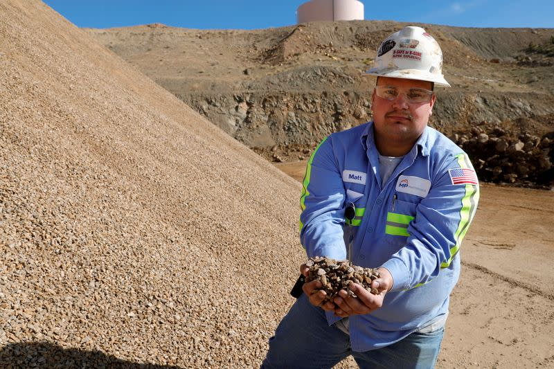 FILE PHOTO: Matt Green, mining/crushing supervisor at MP Materials, displays crushed ore before it is sent to the mill at the MP Materials rare earth mine in Mountain Pass