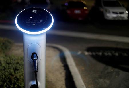 FILE PHOTO: A charging station for electric vehicles is pictured in Pasadena, California, U.S., August 7, 2017. REUTERS/Mario Anzuoni/File Photo