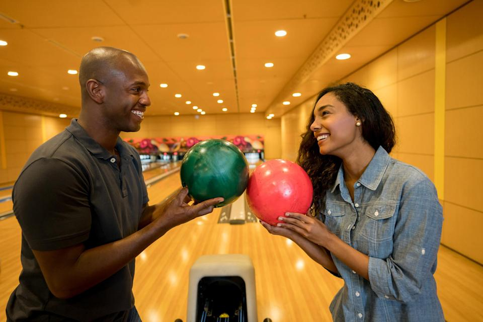 Young couple bowling