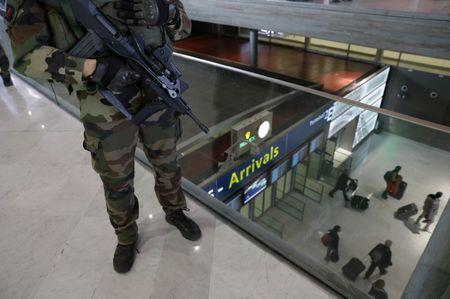A French soldier patrols inside the Charles de Gaulle International Airport in Roissy, near Paris