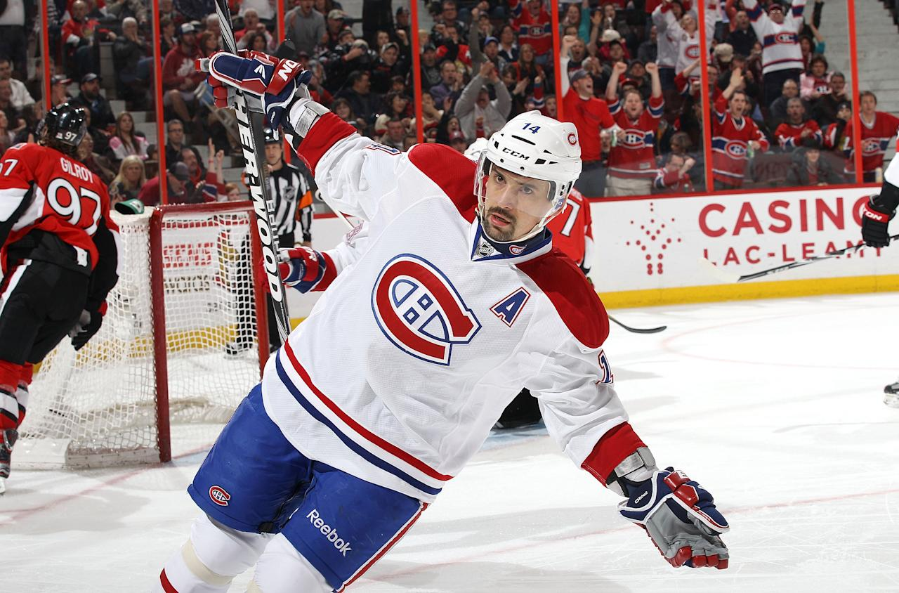 OTTAWA, CANADA - MARCH 16: Tomas Plekanec #14 of the Montreal Canadiens celebrates his first period goal during an NHL game against the Ottawa Senators at Scotiabank Place on March 16, 2012 in Ottawa, Ontario, Canada.  (Photo by Jana Chytilova/Freestyle Photography/Getty Images)