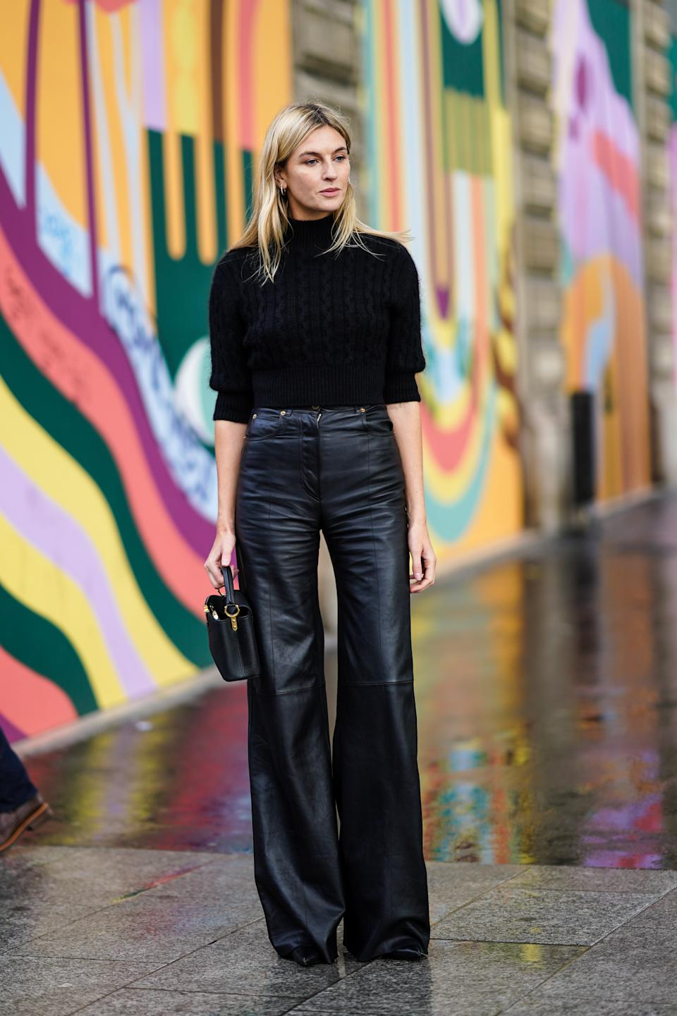 PARIS, FRANCE - OCTOBER 06: Camille Charriere wears a black turtleneck pullover, black leather flared pants, a Vuitton bag, outside Louis Vuitton, during Paris Fashion Week - Womenswear Spring Summer 2021, on October 06, 2020 in Paris, France. (Photo by Edward Berthelot/Getty Images)