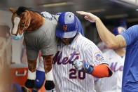 New York Mets' Pete Alonso celebrates after hitting a two-run home run in the sixth inning against the Toronto Blue Jays during a baseball game Sunday, July 25, 2021, in New York. (AP Photo/Adam Hunger)