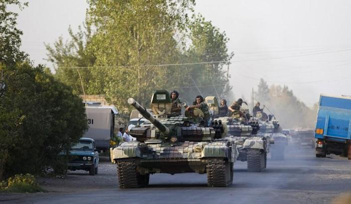 A column of the Azerbaijani tanks moves toward the front line of renewed fighting with Armenian forces in Nagorno-Karabakh on Aug. 2.