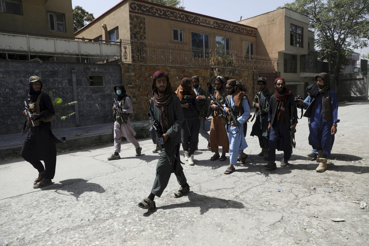 Taliban fighters patrol in the Wazir Akbar Khan neighborhood in the city of Kabul, Afghanistan, Wednesday, Aug. 18, 2021. The Taliban declared an