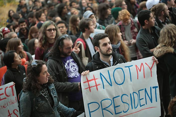 <p>Students at the University of Chicago participate in a walk-out and rally to protest President-elect Donald Trump on Nov. 15, 2016 in Chicago, Ill. The walk-out was one of several staged today on Chicago-area campuses and one of many protests staged nationwide since Trump won the election. (Photo by Scott Olson/Getty Images) </p>