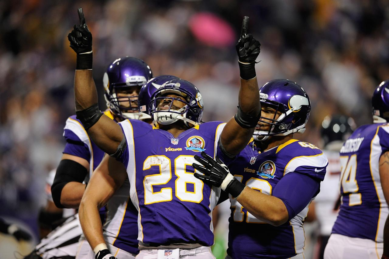 MINNEAPOLIS, MN - DECEMBER 9: Adrian Peterson #28 of the Minnesota Vikings celebrates a touchdown during the first quarter of the game against the Chicago Bears on December 9, 2012 at Mall of America Field at the Hubert H. Humphrey Metrodome in Minneapolis, Minnesota. (Photo by Hannah Foslien/Getty Images)