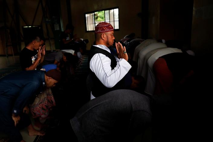 Mohammad Ali Acampong, 42, prays inside a mosque at Mipaga, Marawi City, Lanao del Sur province, Philippines. (Photo: Eloisa Lopez/Reuters)
