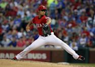 Texas Rangers' Yu Darvish of Japan works against the Boston Red Sox in the third inning of a baseball game, Friday, May 9, 2014, in Arlington, Texas. (AP Photo/Tony Gutierrez)