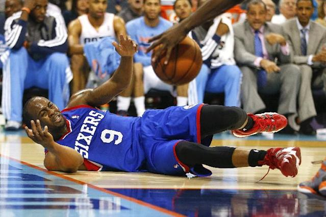 Philadelphia 76ers guard James Anderson (9) reacts as he looses control of the ball against the Charlotte Bobcats during the second half of an NBA basketball game in Charlotte, N.C., Saturday, April 12, 2014. (AP Photo/Chris Keane)