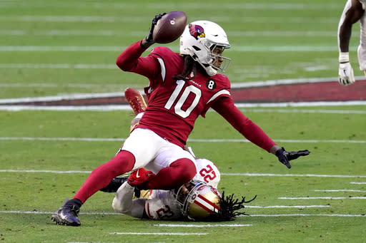 Arizona Cardinals wide receiver DeAndre Hopkins (10) is tackled by San Francisco 49ers cornerback Jason Verrett (22) during the first half of an NFL football game, Saturday, Dec. 26, 2020, in Glendale, Ariz. (AP Photo/Ross D. Franklin)
