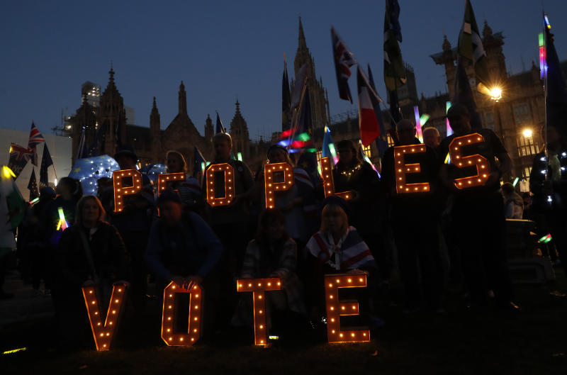 Remain in the European Union demonstrators hold up electrically lit letter asking for a 'People's Vote' opposite the Palace of Westminster in London, Wednesday, Feb. 27, 2019. British Prime Minister Theresa May says she will give British lawmakers a choice of approving her Brexit divorce agreement, leaving the EU March 29 without a deal, or asking to delay Brexit by up to three months. (AP Photo/Alastair Grant)