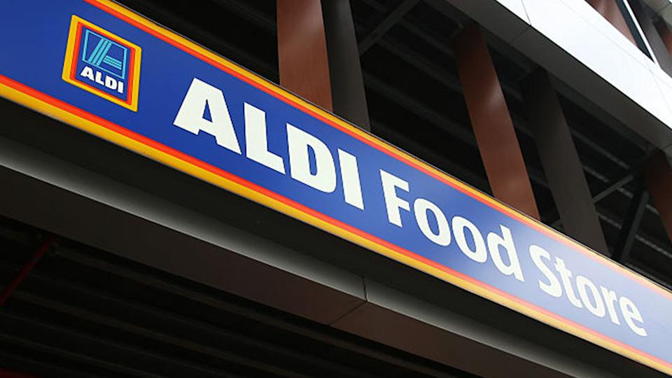 The signage for Aldi Stores Ltd. food store is seen atop one of the company's stores in Sydney, Australia, on Thursday, June 25, 2015. Photo: Getty Images.