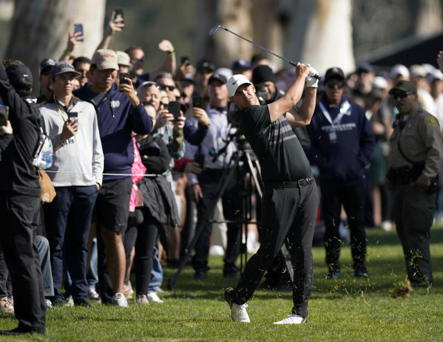 Brooks Koepka hits his second shot from the rough on the 13th hole during the third round of the Genesis Invitational golf tournament at Riviera Country Club, Saturday, Feb. 15, 2020, in the Pacific Palisades area of Los Angeles. (AP Photo/Ryan Kang)