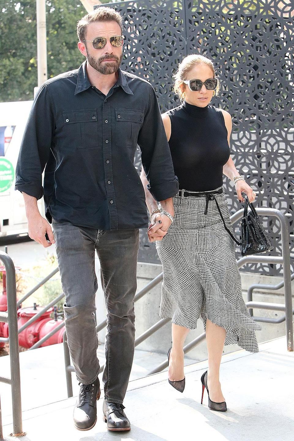 """<p>Just a few days after Affleck was spotted at Tiffany & Co. in the Westfield Century City Mall in Los Angeles, the couple <a href=""""https://people.com/movies/ben-affleck-and-jennifer-lopez-color-coordinate-during-mall-outing/"""" rel=""""nofollow noopener"""" target=""""_blank"""" data-ylk=""""slk:color-coordinated their outfits"""" class=""""link rapid-noclick-resp"""">color-coordinated their outfits</a> for a return trip to the same shopping center on Aug. 24. </p>"""