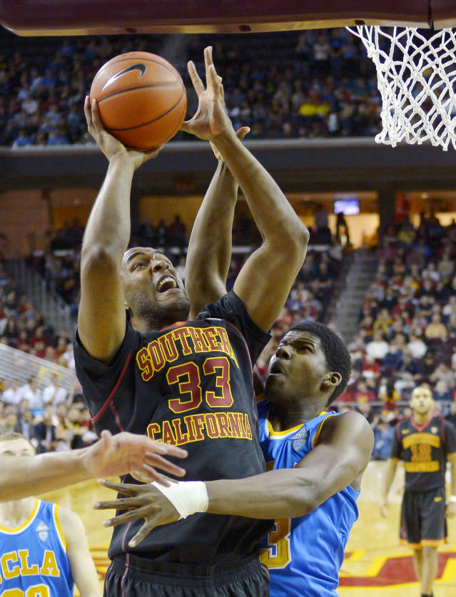 Southern California center D.J. Haley, left, puts up a shot as UCLA center Tony Parker defends during the first half of an NCAA college basketball game, Saturday, Feb. 8, 2014, in Los Angeles. (AP Photo/Mark J. Terrill)