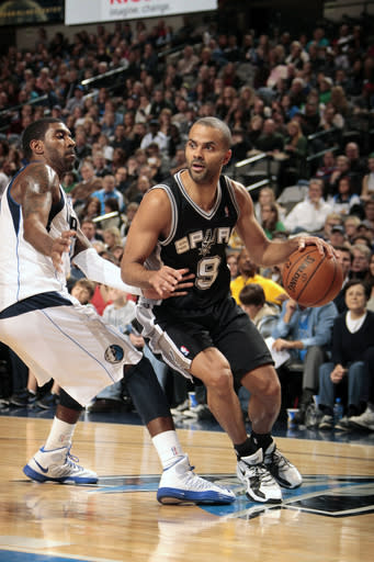 DALLAS, TX - DECEMBER 30: Tony Parker #9 of the San Antonio Spurs drives against O.J. Mayo #32 of the Dallas Mavericks on December 30, 2012 at the American Airlines Center in Dallas, Texas. (Photo by Danny Bollinger/NBAE via Getty Images)