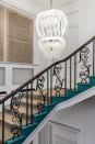<p>Another colorful staircase from Olivia Outred Studio, this one features a dramatic teal color on the stairs paired with natural fibers and a blend of textures. A runner made of natural fibers brings balance and organic elegance to the bold and whimsical paint color, while historic details shine. </p>