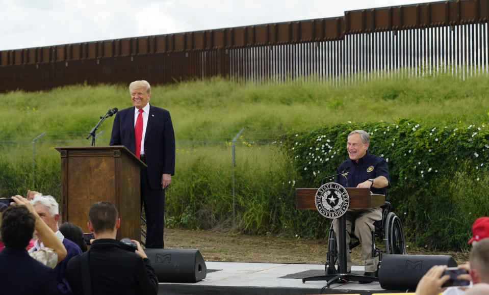 Former President Donald Trump, left, and Texas Gov. Greg Abbott, right, visit an unfinished section of border wall, in Pharr, Texas, Wednesday, June 30, 2021. (AP Photo/Eric Gay)