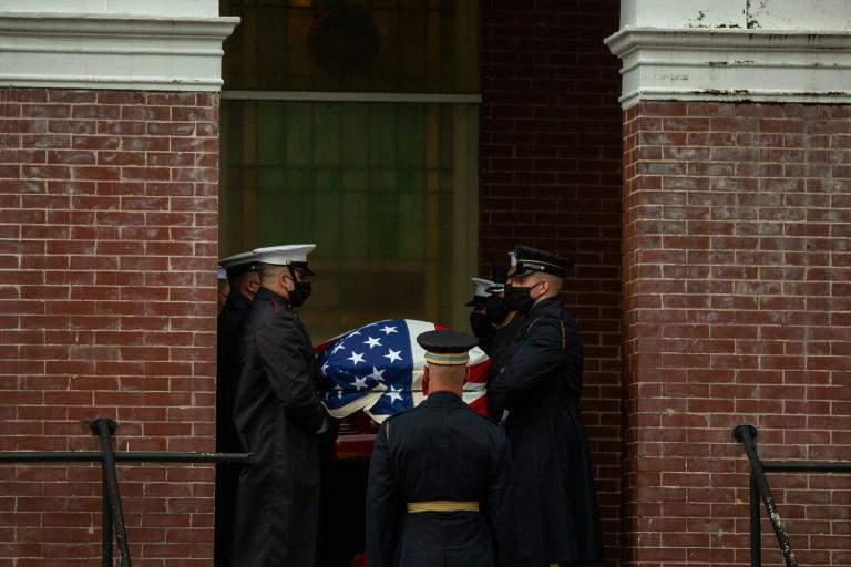 Military pallbearers on July 25, 2020 carry the body of civil rights leader John Lewis into a Selma, Alabama church; a day later his casket was escorted in a final solemn procession across the Selma bridge where he was beaten during a 1965 protest