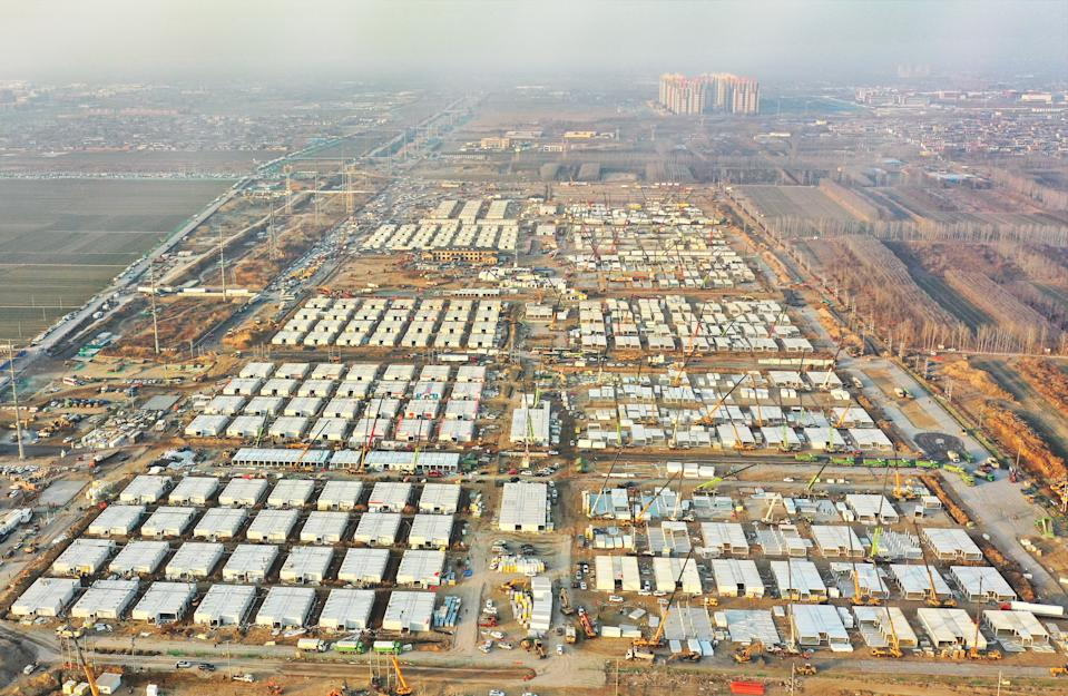 SHIJIAZHUANG, Jan. 18, 2021 -- Aerial photo taken on Jan. 18, 2021 shows the Huangzhuang apartment COVID-19 quarantine center under construction in Shijiazhuang, north China's Hebei Province.   Construction of the main structures of the Huangzhuang apartment COVID-19 quarantine center in Shijiazhuang is nearing the end. With a total floor area of 34 hectares, the facility will house close contacts or secondary close contacts of COVID-19 confirmed cases. (Photo by Yang Shiyao/Xinhua via Getty) (Xinhua/Yang Shiyao via Getty Images)