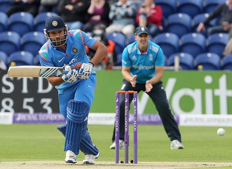 Rohit Sharma (L) of India plays a shot during the second one-day international between England and India at the Glamorgan County Cricket Ground in Cardiff, Wales on August 27, 2014