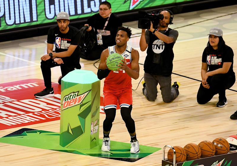 Buddy Hield edged out Devin Booker to win the 3-point contest on Saturday night the United Center.