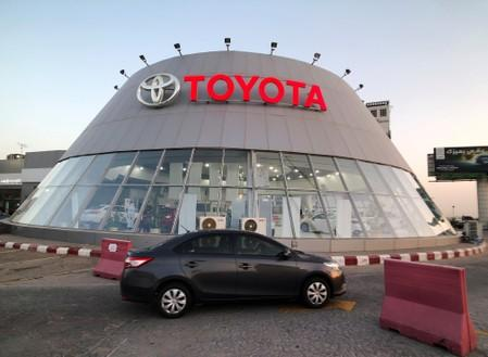 A car passes in front of Toyota dealer in Dhahran, Saudi Arabia