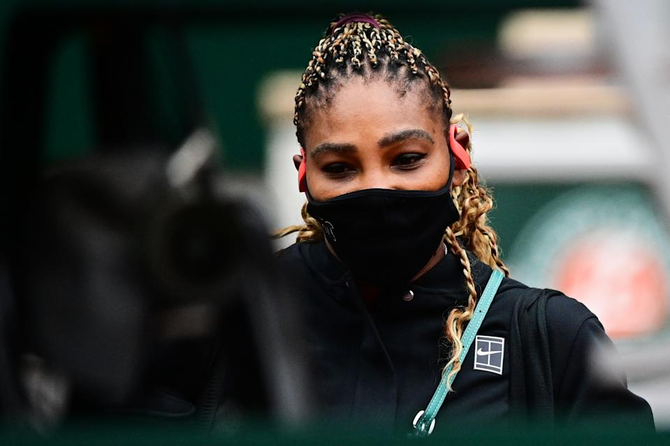 Serena Williams wears a protective face mask as she arrives for her women's singles first round tennis match at Roland Garros 2020.