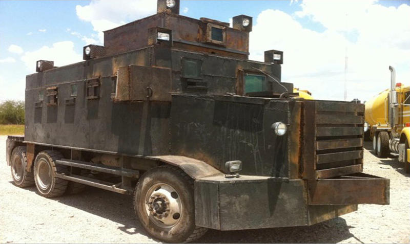 In this image released by Mexico's Defense Department, SEDENA, on Sunday June 5, 2011, a makeshift armored truck is displayed after it was seized on June 4 in the city of Camargo, Mexico. According to Mexico's Defense Department, two makeshift armored trucks were found in a clandestine shop that was being used to create these vehicles. Heavy machinery, weapons and 23 large trucks were also seized during the operation. (AP Photo/SEDENA)
