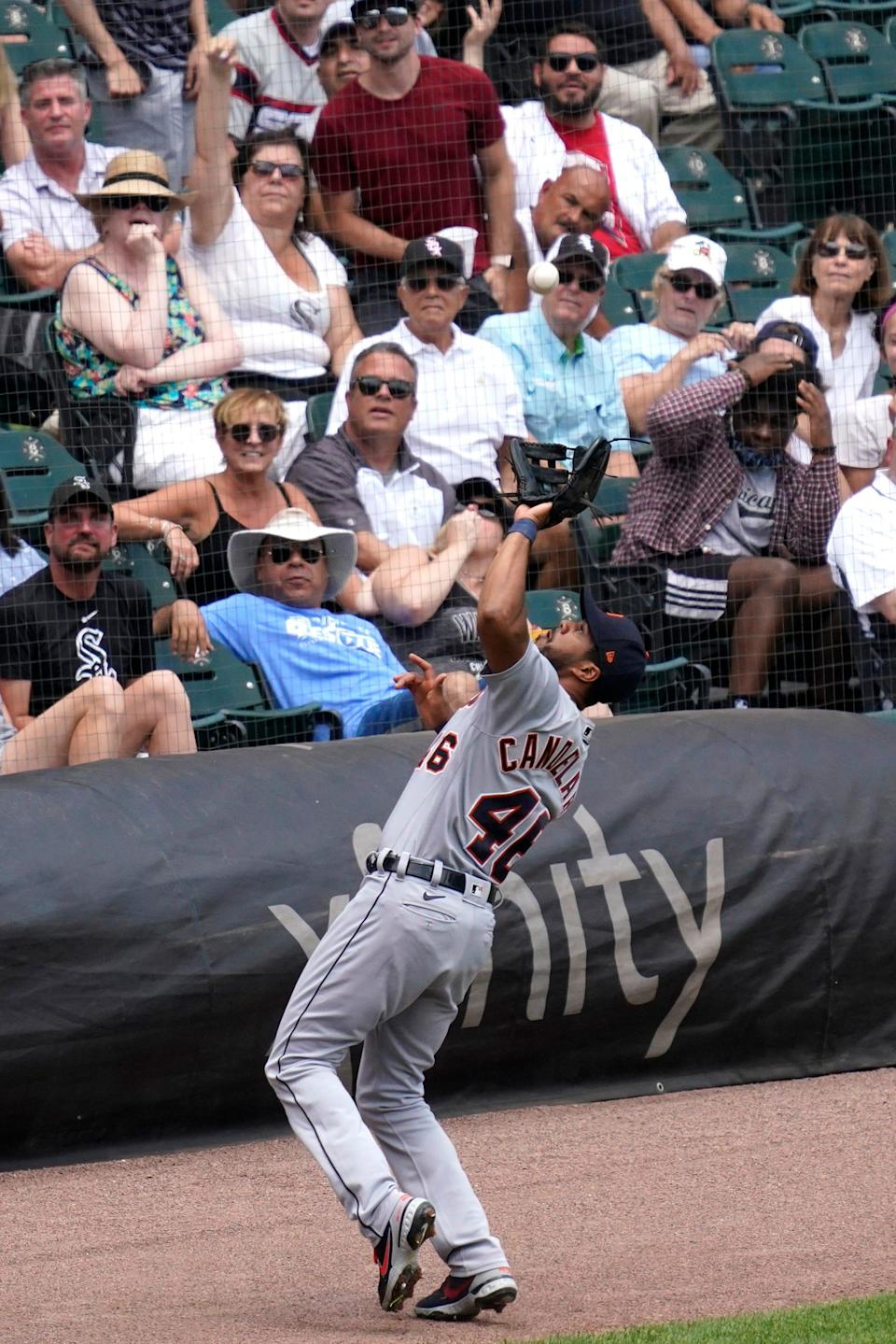 Tigers third baseman Jeimer Candelario catches a fly ball in foul territory during the first inning of the Tigers' 3-0 loss on Sunday, June 6, 2021, in Chicago.
