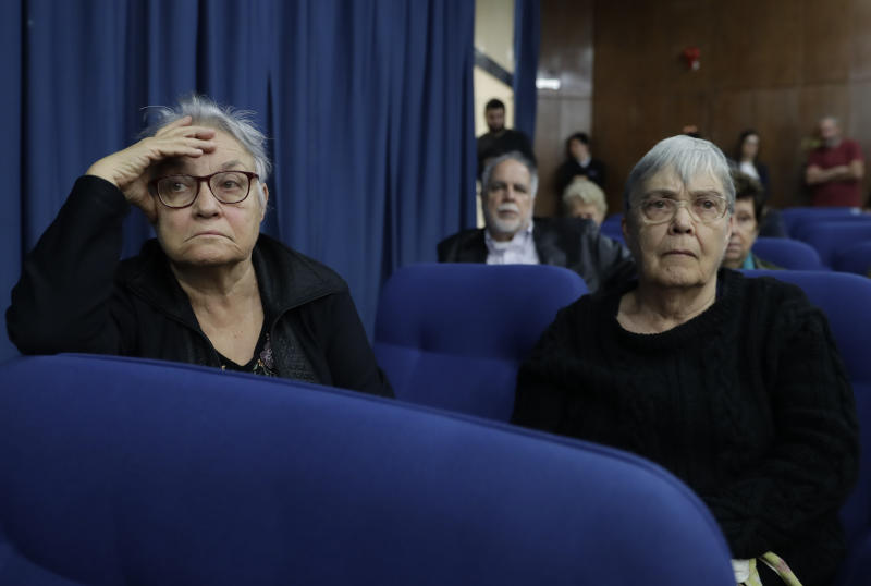 Maria Amelia de Almeida Teles, left, and her sister Crimeia Alice Schmidt de Almeida attend a press conference about the decision by President Jair Bolsonaro to dismiss several members of a commission investigating disappearances and murders committed during Brazil's dictatorship, in Sao Paulo, Brazil, Thursday, Aug. 1, 2019. According to the Almeida sisters, they were detained and tortured by soldiers in 1972, when Crimeia was 8-months pregnant. (AP Photo/Andre Penner)