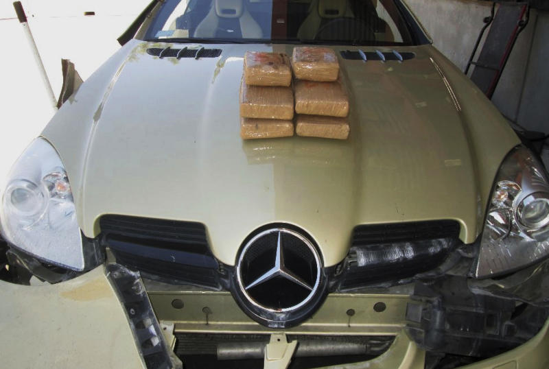 "FILE - This July 20, 2015, file photo released by the Customs and Border Protection Officer of Field Operations shows cocaine valued at $134,000 found by Federal officials on July 19, hidden in a Mercedes-Benz at the crossing at Lukeville, Ariz. Alejandro Hope, a former Mexican intelligence official who is now an independent security analyst, says a new wall as a counter-drug strategy is ""basically a pointless exercise."" He said it's highly likely that all of those shipments were bound for official border crossings because it would not make sense for them to be rerouted to more remote areas where people cross the border illegally on foot. (Customs and Border Protection Officer of Field Operations via AP, File)"