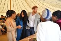 "<p>The royal couple was joined by Meghan's mother, Doria Ragland, during the launch of her <a href=""https://www.townandcountrymag.com/style/fashion-trends/a23322795/meghan-markle-together-cookbook-launch-outfit-blue-smythe-coat/"" rel=""nofollow noopener"" target=""_blank"" data-ylk=""slk:new cookbook"" class=""link rapid-noclick-resp"">new cookbook</a> named <em>Together. </em></p>"