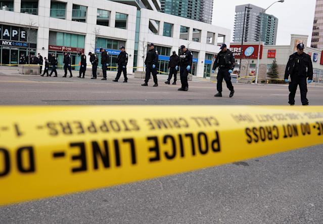 <p>Police officers comb a street for evidence after a van struck multiple people along a major intersection in north Toronto, Ontario, Canada, April 24, 2018. (Photo: Carlo Allegri/Reuters) </p>