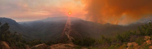 <p>Smoke from the Whittier fire is illuminated by the setting sun in a view from West Camino Cielo road near Santa Barbara, California, U.S. July 11, 2017. (Mike Eliason/Santa Barbara County Fire/Handout via Reuters) </p>