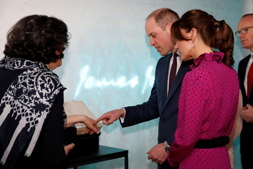 """A first edition copy of James Joyce's novel """"Ulysses"""" is shown to the Duke and Duchess of Cambridge, during a reception held by Irish Tanaiste, Simon Coveney, in Dublin, Ireland."""