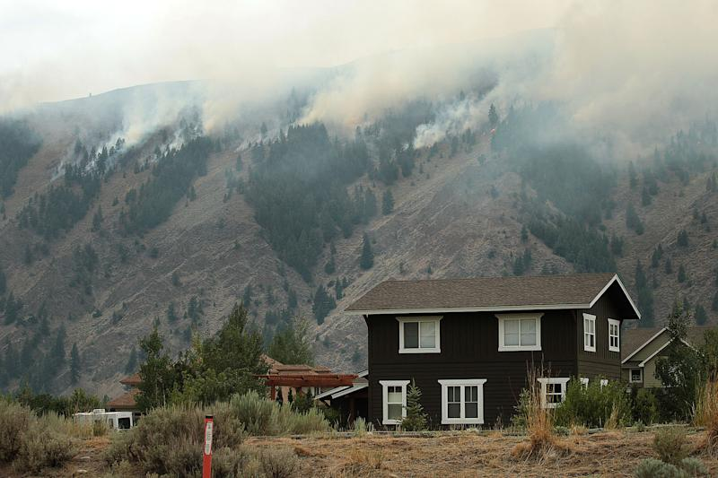 Flames roll down a ridge from the Beaver Creek Fire on Saturday, Aug. 17, 2013 north of Hailey, Idaho.(AP Photo/Times-News, Ashley Smith) MANDATORY CREDIT