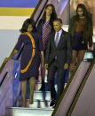 <p>Following a few monumental days in Cuba, President Obama & co. moved onto Argentina, continuing the family's epic spring break. The first lady looked to designer Narciso Rodriguez, a favorite of hers, for the flight, opting for a navy blue dress with an abstract motif. <i>Photo: AP</i></p>