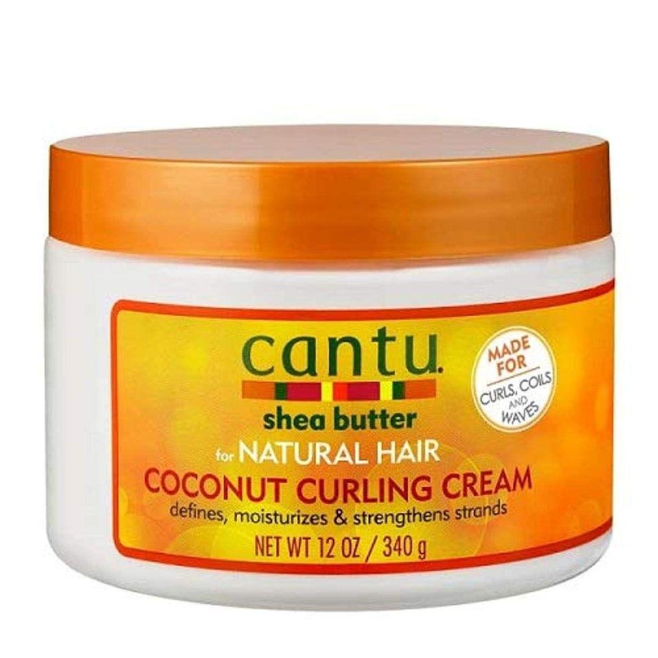 """<p>This 100% pure shea butter styling cream works to moisturize and define your natural curls. Apply this on to damp hair from root to tip and watch your curls come to live. </p><p><a class=""""link rapid-noclick-resp"""" href=""""https://www.amazon.com/Cantu-Coconut-Curling-Cream-Ounce/dp/B01LTIAU6A/ref=dp_fod_1?pd_rd_i=B01LTIAU6A&psc=1&tag=syn-yahoo-20&ascsubtag=%5Bartid%7C10065.g.37036119%5Bsrc%7Cyahoo-us"""" rel=""""nofollow noopener"""" target=""""_blank"""" data-ylk=""""slk:Shop Now"""">Shop Now</a></p>"""